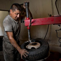 worker tires microcredit portrait